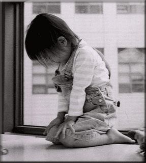 kneeling prayer of kid