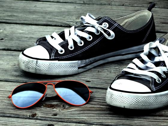 Sneakers on a Pier with Sunglasses